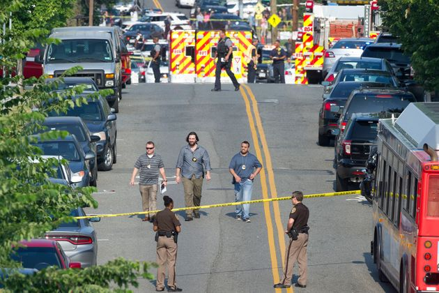 Police and emergency personnel are seen near the scene where House Majority Whip Steve Scalise of La....