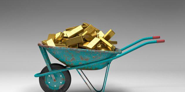 Rusty wheelbarrow full of gold