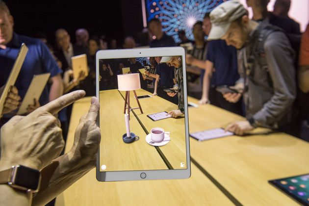 An attendee demonstrates the ARKit, augmented reality tool, on an Apple Inc. iPad Pro during the Apple...