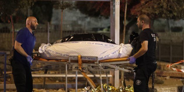 Israeli forensic police remove the bodies suspected Palestinian assailants outside Damascus Gate in Jerusalem's...