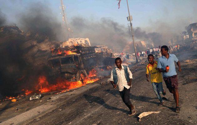 Civilians evacuate from the scene of an explosion in KM4 street in the Hodan district of Mogadishu, Somalia...