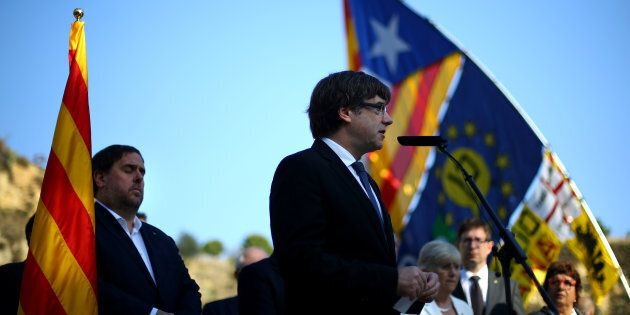 Catalan President Carles Puigdemont delivers a speech at the memorial