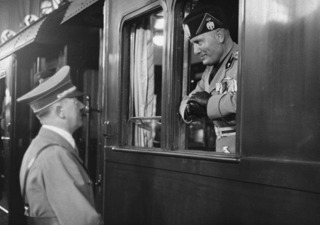 The Italian dictator Benito Mussolini is seen off in his armoured train from Berlin, by his German counterpart...