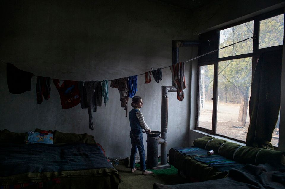 Harmanli. Bulgaria. Nov. 19, 2013. A young girl from Syria cooking inside the Harmanli camp. The biggest...