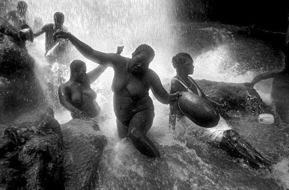 Haiti, Saut D'eau, voodoo pilgrimage for the spirit Ewa Ezili. Remaining underneath the waterfall allows...