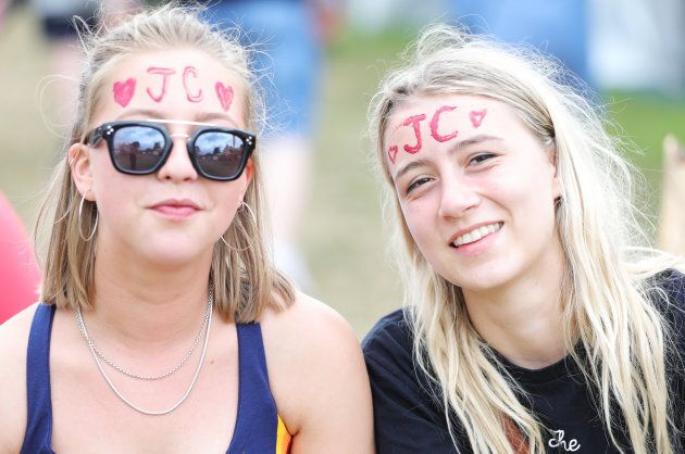 GLASTONBURY, ENGLAND - JUNE 24: Festival goers with Jeremy Corbyn's initials on their head attend day...