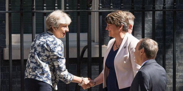 Prime Minister Theresa May greets DUP leader Arlene Foster, DUP deputy leader Nigel Dodds and DUP MP...