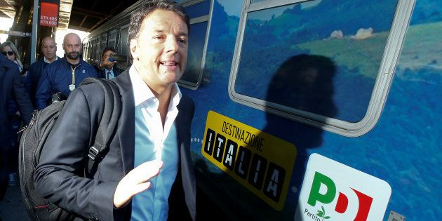 Italy's Former Prime Minister Matteo Renzi arrives to board a train during his electoral