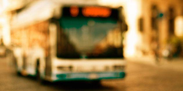 Bus driving in an Italian City. Tilt