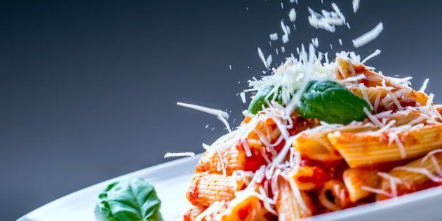 Pasta Penne with Tomato Bolognese Sauce, Parmesan Cheese and Basil Leaves. Mediterranean food.Italian...
