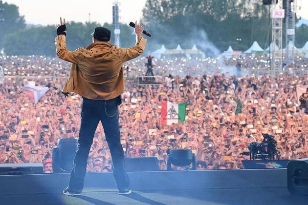 Italian singer-songwriter Vasco Rossi performs on stage during a concert at Parco Ferrari in Modena,...