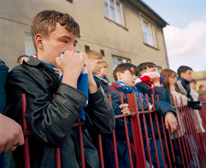 GB. Scotland. Glasgow. Rangers fans at the funeral of player Davie Cooper. He died of a brain haemorrhage,...