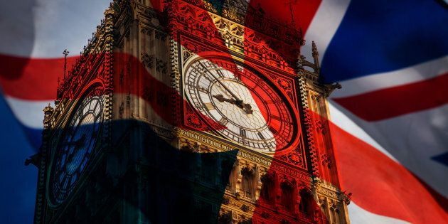 union jack flag and iconic Big Ben at the palace of Westminster, London - the UK prepares for new