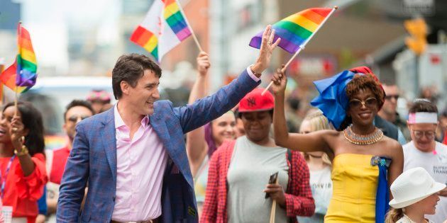 Prime Minister Justin Trudeau waves to the crowd as he marches in the Pride Parade in Toronto, June 25,...