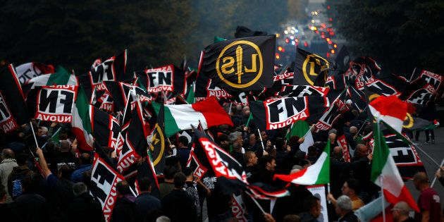 Supporters of Italy's far-right Forza Nuova party wave flags during a demonstration in Rome, Italy November...