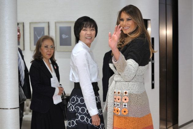 First lady of the United States Melania Trump is welcomed by Japan's First Lady Akie Abe as she arrives...