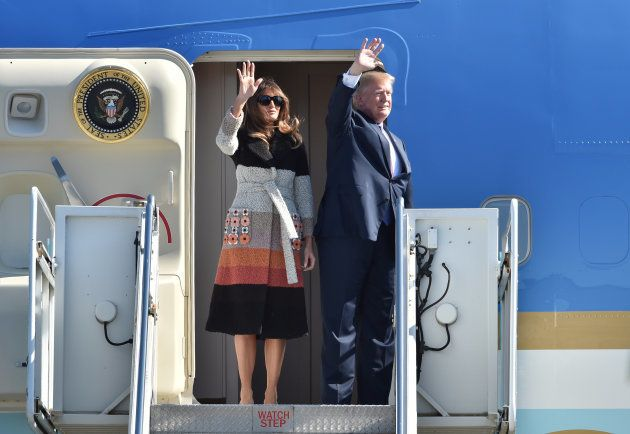 U.S. President Donald Trump (R) and his wife Melania (L) step off Air Force One upon arrival at Yokota...