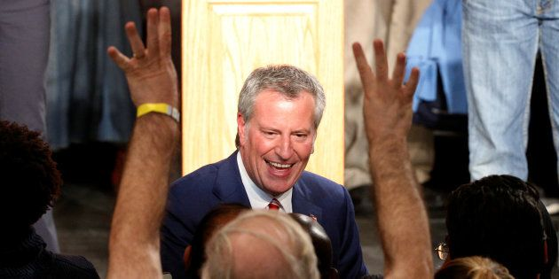 New York Mayor Bill de Blasio is greeted by supporters after his re-election in New York City, U.S. November...