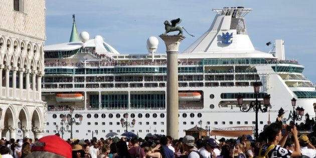 A cruise ship is seen in Venice lagoon passing beside the Piazetta next to the Piazza San Marco (St.Mark's...
