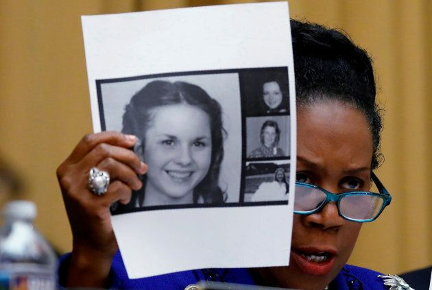 Rep. Sheila Jackson Lee (D-TX) holds up pictures of women who've accused U.S. Senate candidate Roy Moore...
