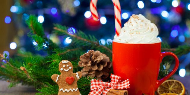 Christmas cappuccino and gingerbread cookies infront Christmas tree. Used gingerbread cookies home-handedly...