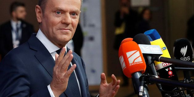 EU Council President Donald Tusk speaks on arrival at the EU summit in Brussels, Belgium, December 14,...