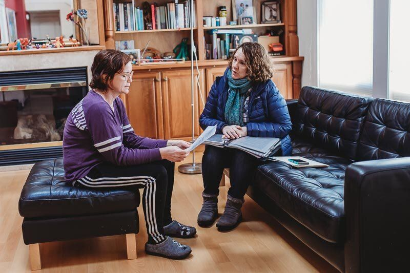 Garcia meeting with a community member while door-to-door organizing.