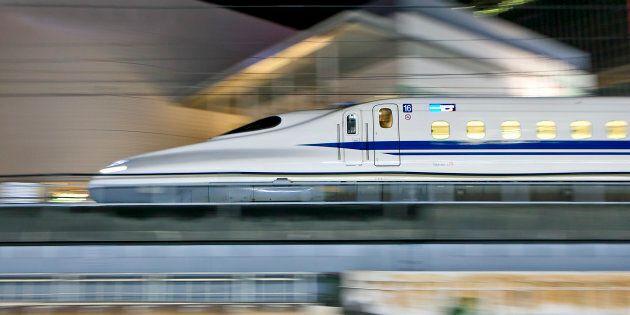 Tokyo, Japan - September 4, 2014: N700 series Shinkansen bullet train approaches Tokyo Station in the