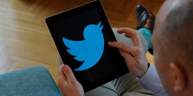 A man is seen holding an iPad with a Twitter logo on it's screen on November 10, 2017. (Photo by Jaap...
