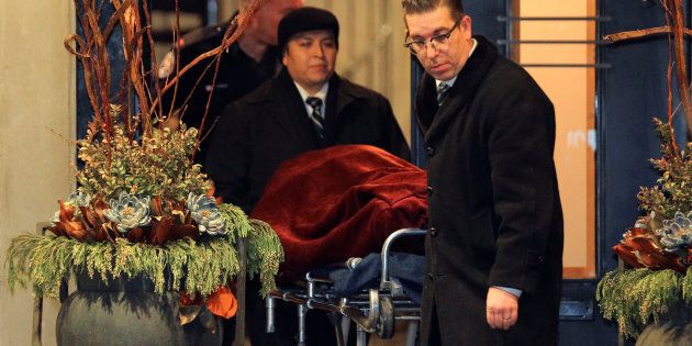 One of two bodies is removed from the home of billionaire founder of Canadian pharmaceutical firm Apotex...