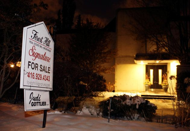 A For Sale sign stands outside the home of billionaire founder of Canadian pharmaceutical firm Apotex...