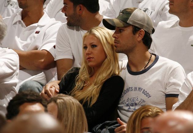 MIAMI - MAY 8: Tennis player Anna Kournikova and singer Enrique Iglesias watch the New Jersey Nets play...