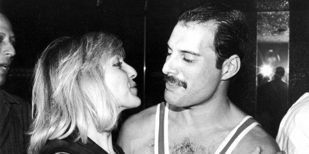 From left to right, singer Freddie Mercury (1946 - 1991) of British rock band Queen with his friend Mary...