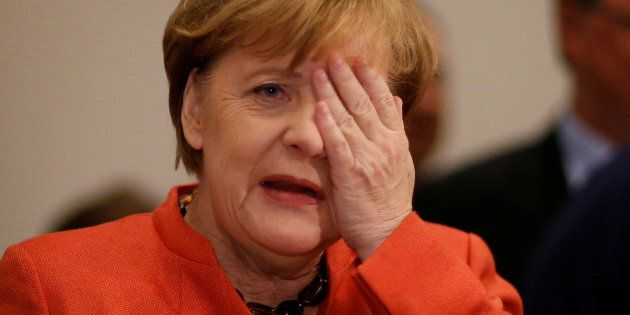 German Chancellor Angela Merkel gestures at a CDU/CSU parliamentary group meeting at the Bundestag in...