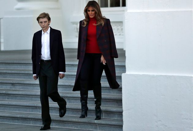 First Lady Melania Trump and her son Barron Trump welcome the official White House Christmas Tree, a...