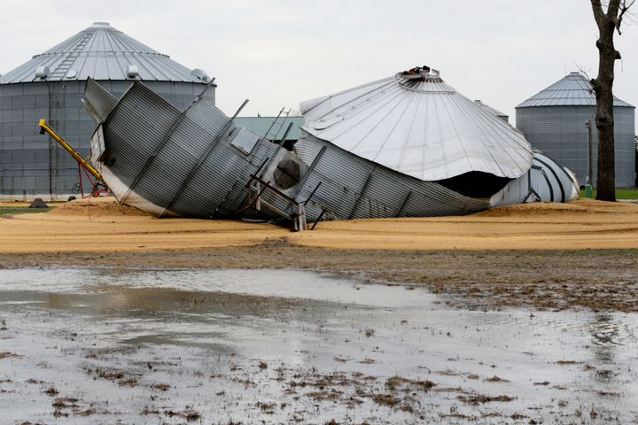 In this April 10, 2019 photo, flood waters from the Missouri River destroyed grain silos and washed soybeans out of them, on