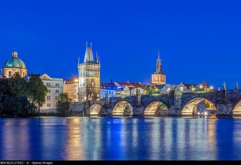 Charles Bridge and city illuminated at dusk, Prague, Czech