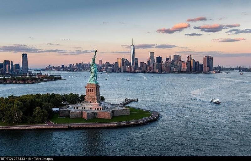 Aerial view of city with Statue of Liberty at