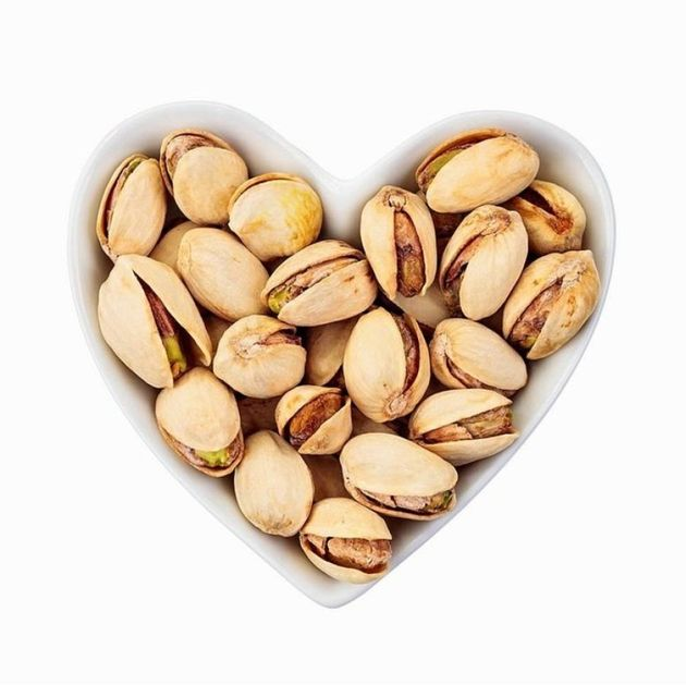 Pistachio nuts in a heart-shaped