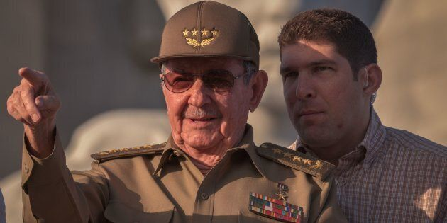 Cuban President Raul Castro, next to his grandson and bodyguard, Raul Rodriguez