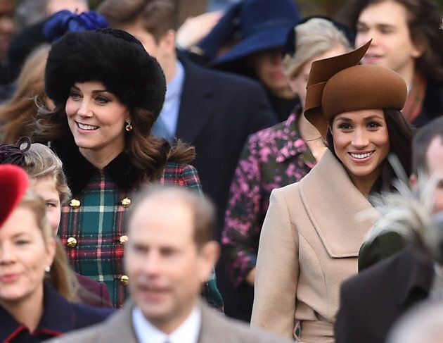 The Duchess of Cambridge (left) and Meghan Markle arriving to attend the Christmas Day morning church...