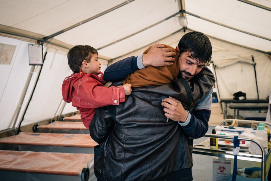 A man hugs his sister at the MSF trauma center. The siblings have not seen each other for over two years...