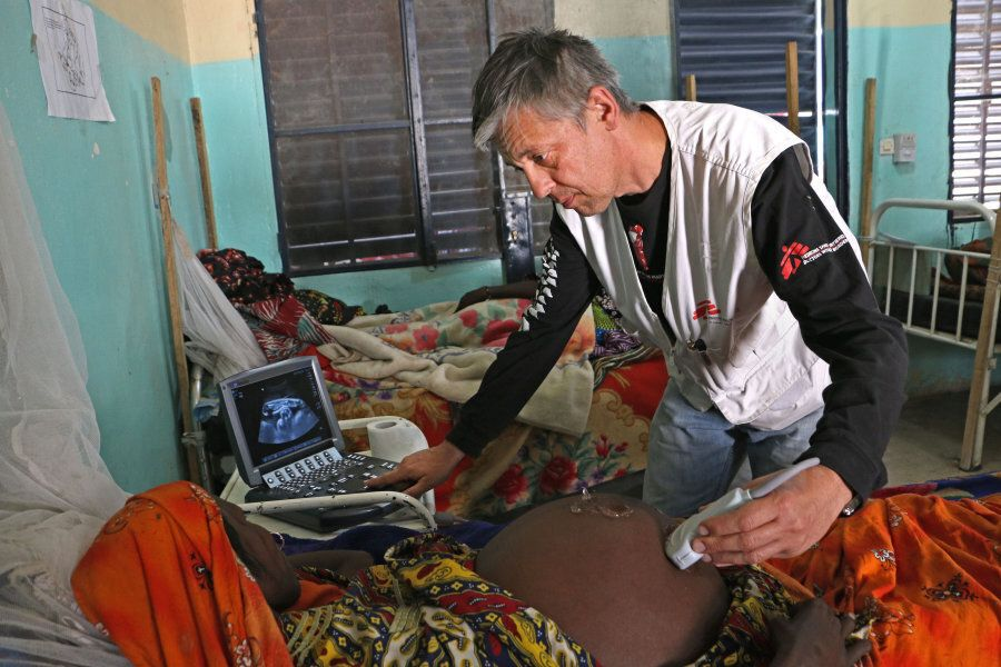 Dr. Henryk Mazurek, MSF gynaecologist-obstetrician conducts an ultrasound on a patient who is about to...