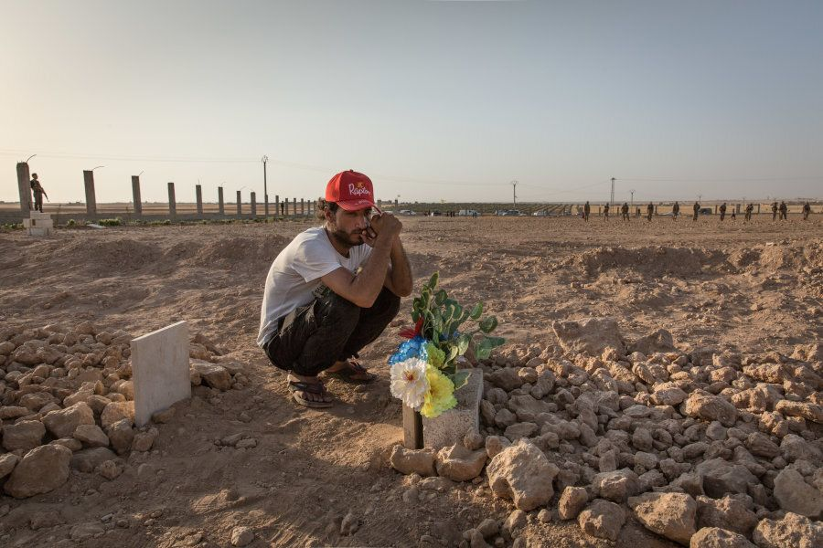 Syria - Tal Abyad. Ismael bitterly gathered at the grave of Hout, his friend and cousin, who died in...