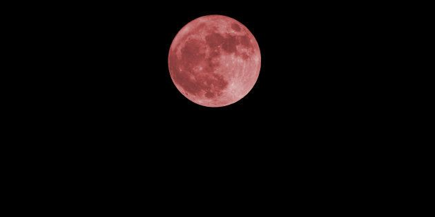 red full moon on the dark sky in