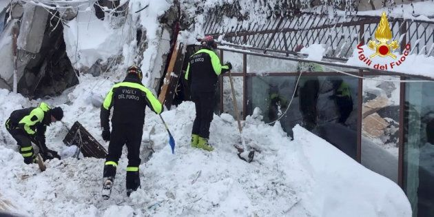 Firefighters work at Hotel Rigopiano in Farindola, central Italy, after it was hit by an avalanche, in...
