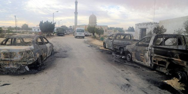 Damaged vehicles are seen after a bomb exploded at Al Rawdah mosque in Bir Al-Abed, Egypt November 25,...