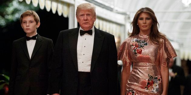 President Donald Trump arrives for a New Year's Eve gala at his Mar-a-Lago resort with first lady Melania...