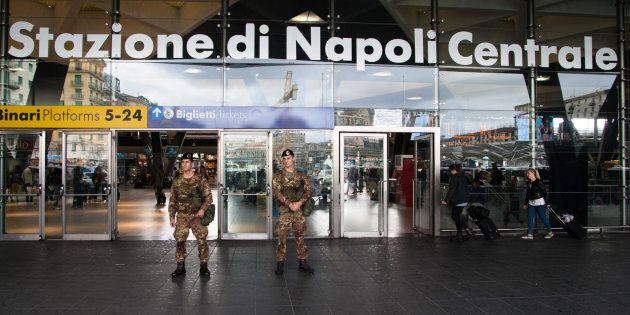 Italian troops stand guard outside the Central Station by Naples, Campania Grouping, Commandant is Colonel...