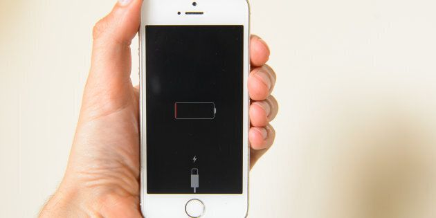 Generic stock photo shows an iPhone smartphone displaying a low battery warning. (Photo by Dominic Lipinski/PA...